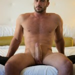 Horny Nude Man Sitting On A Bed